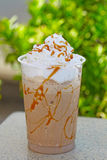 Iced coffee. In plastic cup with straw stock image