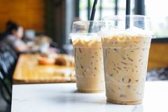 Iced coffee in plastic glass at coffee shop stock photography