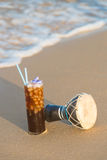 Iced coffee on the sand Royalty Free Stock Images