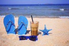 Iced coffee on a sandy beach Royalty Free Stock Photo