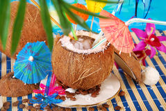 Iced coffee served in coconut shell. On tropical beach royalty free stock images