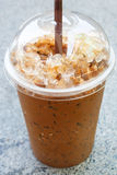 Iced Coffee. Iced coffee with straw in plastic cup royalty free stock photo