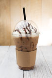Iced coffee. With straw in plastic cup royalty free stock photos