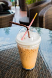 Iced coffee with straw and in plastic cup Royalty Free Stock Photos