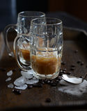 Iced coffee sugar spoon. Wooden tray of brewed iced coffee with sugar heart and coffee beans, breakfast in bed Stock Photo
