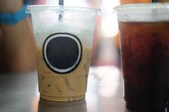 Iced coffee in takeaway cup. Close up Stock Images