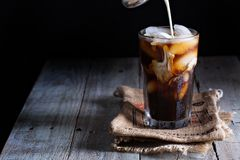 Iced coffee in a tall glass Royalty Free Stock Image