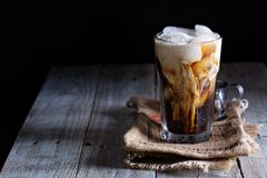 Iced coffee in a tall glass Royalty Free Stock Photos