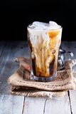 Iced coffee in a tall glass Stock Images