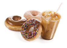 Iced Coffee and Three Donuts on White Background Royalty Free Stock Image