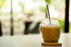 Iced coffee with tube on the table at the cafe stock photos
