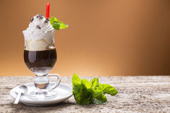 Iced coffee with whipped cream, decorated with mint Stock Photo