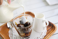 Iced coffee on white wood background Stock Photography