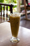 Iced coffee. On wood table royalty free stock photography