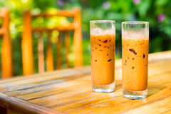 Iced coffees on a hot day outdoors. Two iced coffee drinks on a table outdoor Royalty Free Stock Photo