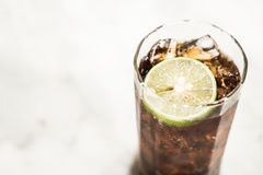 Iced coke glass. With lemon - soft focus and filter effect Stock Photo