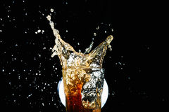 Iced coke splash Stock Photos