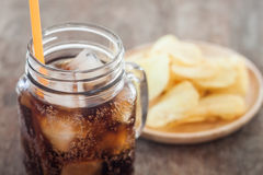 Iced cola with potato chips Stock Image