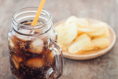 Iced cola with potato chips Royalty Free Stock Images