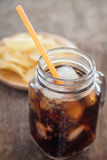 Iced cola with potato chips Stock Photo
