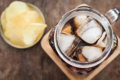 Iced cola with potato chips Royalty Free Stock Image