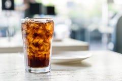 Iced cola on the table. Iced cola glass on the table stock photos