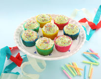 Iced Cup Cakes. A plate of delicious iced cup cakes for a birthday celebration stock photo