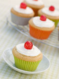 Iced Cup Cakes with Glace Cherries Royalty Free Stock Photos