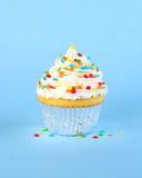 Iced cupcake with colorful sprinkles Royalty Free Stock Images