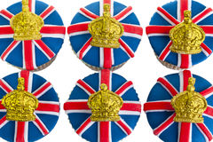Iced cupcakes. Cupcakes decorated with Union Jack and crown icing Stock Photos