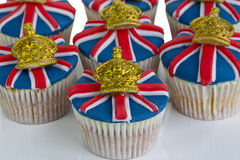 Iced cupcakes. Cupcakes decorated with Union Jack and crown icing Royalty Free Stock Images