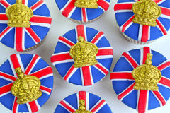 Iced cupcakes. Cupcakes decorated with Union Jack and crown icing Royalty Free Stock Photography