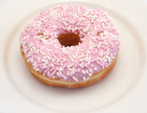 Iced Donut. Single lonely iced donut on a plate Royalty Free Stock Image