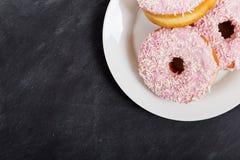 Iced doughnut on a blackboard background Stock Image