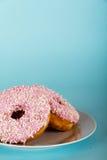 Iced doughnut on a light blue background Stock Photo