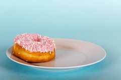 Iced doughnut on a light blue background Stock Image