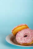 Iced doughnut on a light blue background Stock Images