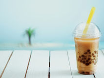 Iced drink in a covered cup royalty free stock photo
