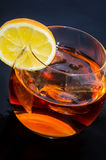 Iced drink. Glass of iced alcohol drink with lemon. Over dark blue background Royalty Free Stock Images