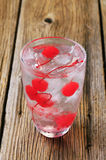 Iced drink with maraschino cherries Stock Photography