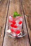 Iced drink with maraschino cherries Royalty Free Stock Image