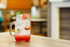 Iced Drink With Strawberry And Lemon Stock Image