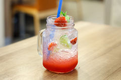 Iced Drink With Strawberry And Lemon Stock Photo