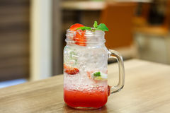 Iced Drink With Strawberry And Lemon Stock Photography