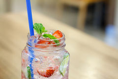 Iced Drink With Strawberry And Lemon Royalty Free Stock Photos