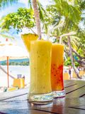 Iced drinking smoothies glass on wooden table. With sea and ocean view for relax stock photo