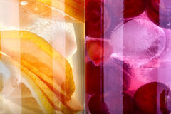 Iced drinks. With cherry and orange as background stock photography