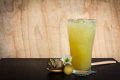Iced drinks from sugar cane. On wooden table in summer royalty free stock images