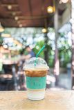 Iced expresso coffee. On wooden bar royalty free stock image