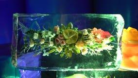 Frozen flowers, iced flowers, floral bouquets locked in blocks of ice. Iced flowers, freshly frozen flowers stock video footage